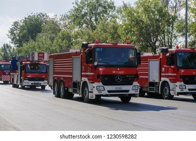 Thessaloniki, Greece - October 28 2018: Greek Fire Service trucks during Oxi Day parade. Hellenic Fire Brigade vehicles with Greek firefighters in uniform at national day celebration parade.