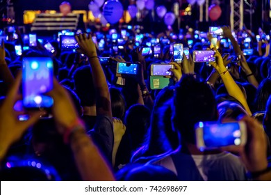 Thessaloniki , Greece - Sept 17 , 2017: People taking photographs with touch smart phone during a music concert live on stage for the Saikis Rouvas consert in Thessaloniki.