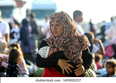 Thessaloniki, Greece – Sept 2, 2019: Refugees and migrants disembark to the port of Thessaloniki after being transfered from the refugee camp of Moria, Lesvos island.