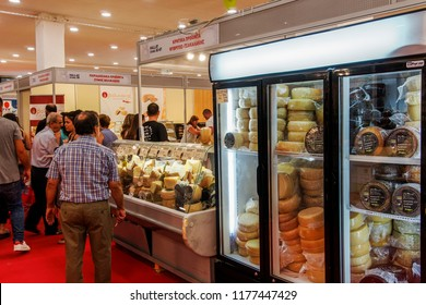 Thessaloniki, Greece - September 10 2018: Greek dairy products on display during 83rd International Fair. Refrigerated Greek cheese products inside hall stands with crowd at fair pavilion.