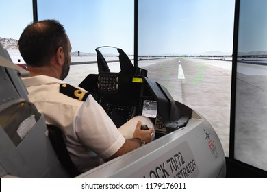 Thessaloniki, Greece - September 10, 2018. A Navy Officer flies at an F-16 Simulator during Thessaloniki International Fair 2018.