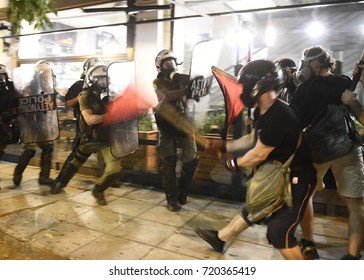 Thessaloniki, Greece - September 18, 2017. Anarchists and police officers are seen clashing with motion blur effect during an antifascist protest in memory of the Greek rap singer Pavlos Fyssas.