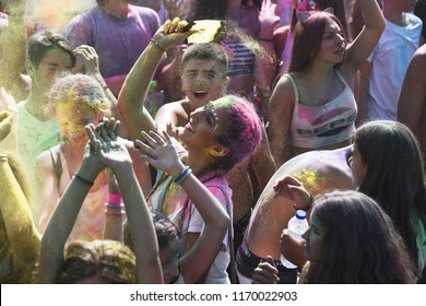 """Thessaloniki, Greece - September 2, 2018. People throw colour powder during the """"Day of Colours"""" annual event."""
