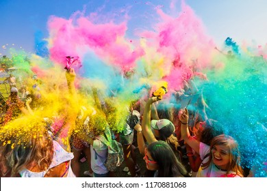 "Thessaloniki, Greece - September 2, 2018: Crowds of unidentified people throw colour powder during the ""Day of Colours"" annual event."
