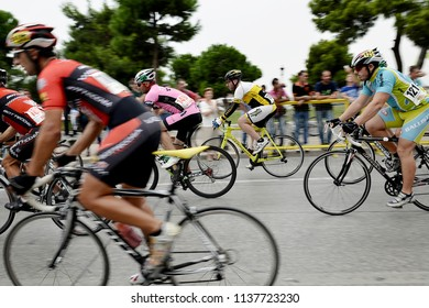 Thessaloniki, Greece - September 20, 2014. Cyclists in action are seen with panning view effect during a race at the center of the city of Thessaloniki.