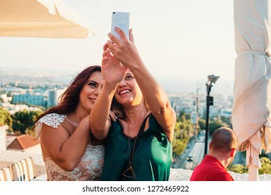 Thessaloniki, Greece - September 2018: Two girlfriends take a photo during a wedding party