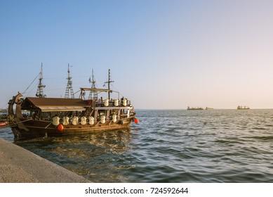Thessaloniki, Greece. September 21, 2017; Beautiful sunset with wooden ship in Thessaloniki.
