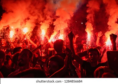 Thessaloniki, Greece - September 22, 2018: Music fans burn fire torch on wild rock concert at the open theater of the city of Thessaloniki. Crowd on festival.Dangerous flammable fireworks