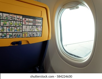 Thessaloniki, Greece - September 23 2016: Ryanair aircraft seat info by window.  New seat inside a Ryanair Boeing 737 800 aircraft with safety info card.