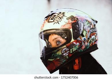 Thessaloniki/Greece - 7 June 2020 :Woman wearing a motorcycle helmet .