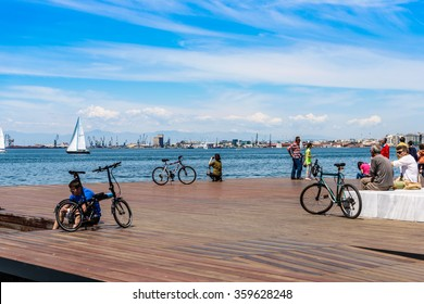 Thessaloniki,Greece - May 11.2014:People are relaxing with their bikes next to the harbor of Thessaloniki Greece on a sunny day