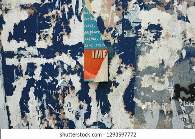 Thessaloniki/Greece - November 2011: Close up of Torn Posters on a street wall