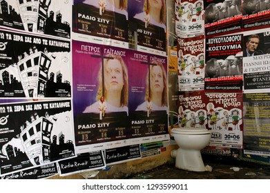 Thessaloniki/Greece - November 2011: Street posters and abandoned toilet seat