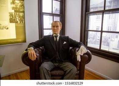 Thessaloniki-Greece, September 17 2019: Wax statue of Mustafa Kemal Ataturk. Sitting on armchair in the home where he was born