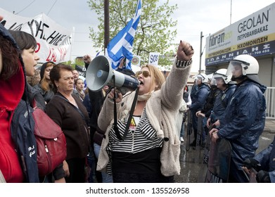 THESSALONIKI,GREECE-APR,14:Demonstrators shout slogans outside the police station during a protest against the arrest of residents for attacking a Canadian Eldorado Gold,in Thessaloniki,14 April 2013