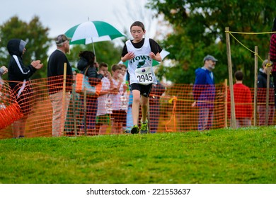 THETFORD CENTER, VT, USA - OCTOBER 4, 2014: Middle school boys running the 24th annual Thetford Academy Woods Trail Run, middle school boys division.