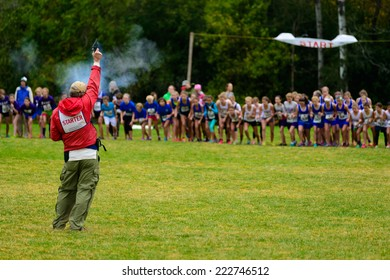 THETFORD CENTER, VT, USA - OCTOBER 4, 2014: The start of the 24th annual Thetford Academy Woods Trail Run, girls middle school division.