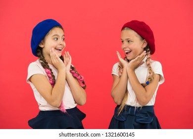 They are really cute. French style girls. Girls having the same hairstyle. Small children with long hair plaits. Fashion girls with tied hair into braids. Little kids wearing stylish french berets.