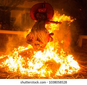 A Theyyam artist performs in night at kandanar kelan theyyam temple on  Payyannur, India.Theyyam is a ritualistic traditional art form of Kerala.