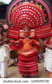 Theyyam, KANNUR - APRIL: 28 A Theyyam artist performs during the annual festival at Puliroopa kaali temple on April, 2015 in Kannur, India.Theyyam is a ritualistic folk art form of Kerala -