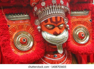 Theyyam, KANNUR - APRL 04: A Theyyam artist performs during the annual festival at Ramapuram,Puliroopakaali temple on April 04, 2017 in Kannur, India.Theyyam is a ritualistic folk art form of Kerala