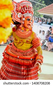 Theyyam, KANNUR - APRL 27: A Theyyam artist performs during the annual festival at Ramapuram,Puliroopakaali temple on April 27, 2017 in Kannur, India.Theyyam is a ritualistic folk art form of Kerala