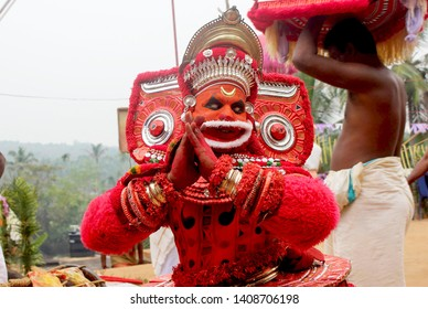 Theyyam, KANNUR - APRL04: A Theyyam artist performs during the annual festival at Ramapuram,Puliroopakaali temple on April 04, 2017 in Kannur, India.Theyyam is a ritualistic folk art form of Kerala