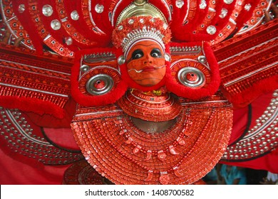 Theyyam, KANNUR - APRL27: A Theyyam artist performs during the annual festival at Ramapuram,Puliroopakaali temple on April 27, 2017 in Kannur, India.Theyyam is a ritualistic folk art form of Kerala