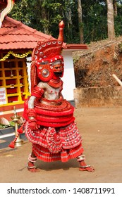 Theyyam, KANNUR - DEC 10: A Theyyam artist performs during the annual festival at Ramapuram,Puliroopakaali temple on December 10, 2017 in Kannur, India.Theyyam is a ritualistic folk art form of Kerala