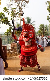Theyyam, KANNUR - DEC 10: A Theyyam artist performs during the annual festival at Mannummal temple on December 10, 2017 in Kannur, India.Theyyam is a ritualistic folk art form of Kerala