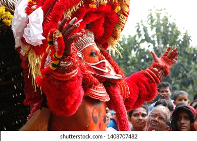 Theyyam, KANNUR - DEC 11: A Theyyam artist performs during the annual festival at Mannummal temple on December 11, 2017 in Kannur, India.Theyyam is a ritualistic folk art form of Kerala