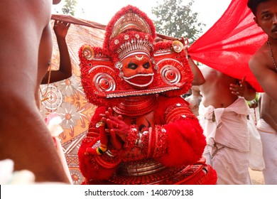 Theyyam, KANNUR - DEC 11: A Theyyam artist performs during the annual festival at Ramapuram,Puliroopakaali temple on December 11, 2017 in Kannur, India.Theyyam is a ritualistic folk art form of Kerala
