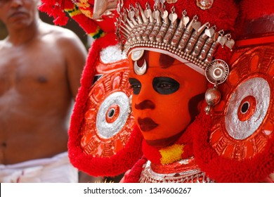 Theyyam, KANNUR - DEC 12: A Theyyam artist performs during the annual festival at Eramam, Kaninjeri temple on December 12, 2017 in Kannur, India.Theyyam is a ritualistic folk art form of Kerala -
