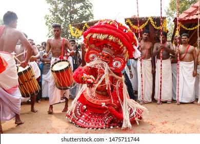 Theyyam, KANNUR - DEC 12: A Theyyam artist performs during the annual festival at Eramam Mannummal on December 12, 2018 in Kannur, India.Theyyam is a ritualistic folk art form of Kerala