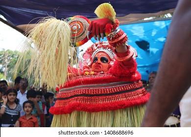 Theyyam, KANNUR - FEB 03: A Theyyam artist performs during the annual festival at Ramapuram Tharavaadu onFebruary 03, 2019 in Kannur, India.Theyyam is a ritualistic folk art form of Kerala