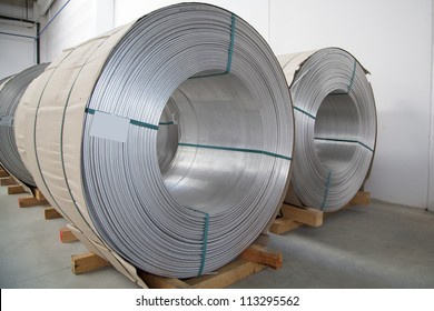 Thick aluminium wire spools in wire stretching factory