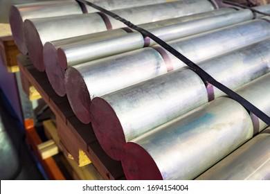 Thick aluminum rods. Aluminum warehouse. Remelting non-ferrous metals. Metallurgy. Manufacture of non-ferrous metal products. Foil production. Aluminum is in stock. Metallurgical enterprise.