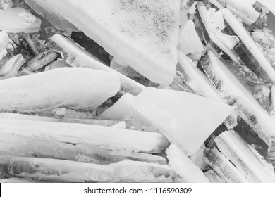 thick broken ice. ice. frozen water, blue and white pieces with frost crystal structure textured surface on abstract glacial background. Winter, nature