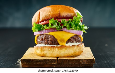 thick cheeseburger with american cheese, lettuce tomato and onion