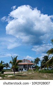 Thick clouds floating over small house in Varadero, Cuba.