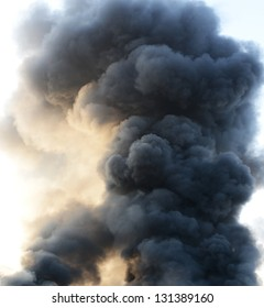 thick dark smoke in a fire.