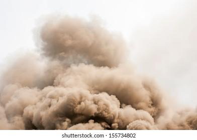 thick dark smoke in a fire.