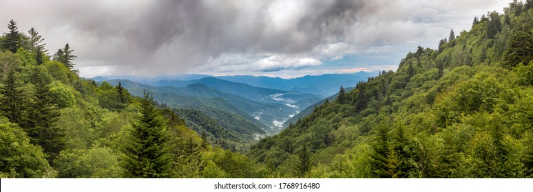 Thick early morning clouds roll over the blue ridges of the Appalachian Range in Great Smoky Mountains National Park near the border of North Carolina and Tennessee.