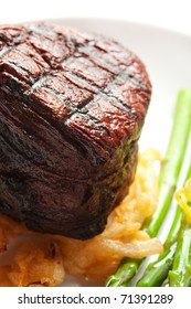 Thick Filet mignon served with crispy onions and asparagus