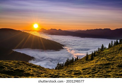 Thick fog in the mountains at dawn. Sunrise fog in mountains. Mountain fog at dawn. Sunsrise fog landscape
