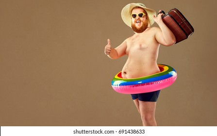 Thick funny man in swimming trunks wearing a hat and crocheted o