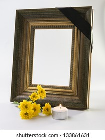 thick gold frame with candle