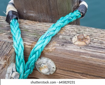 Thick hawser rope eye spliced to dock.