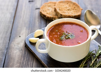 Thick Italian soup minestrone on a wooden table