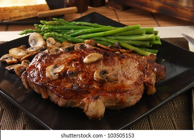 A thick juicy broiled steak topped with sauteed mushrooms